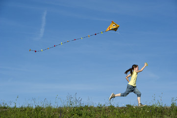 happy girl flying her kite