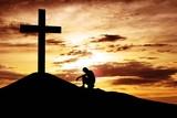 Fototapety Man sitting desperately under the cross