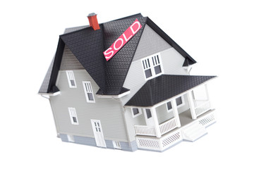 House architectural model with Sold sign, isolated