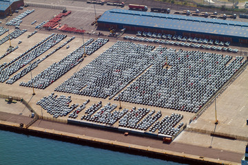 aerial view of large amount of automobiles parked at harbour