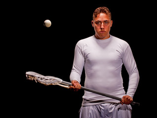 Lacrosse player isolated on black background
