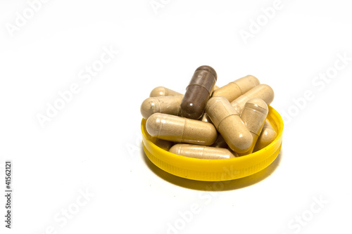 The ancient herbal capsule in yellow cap