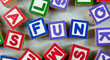 Wooden blocks forming the word FUN in the center