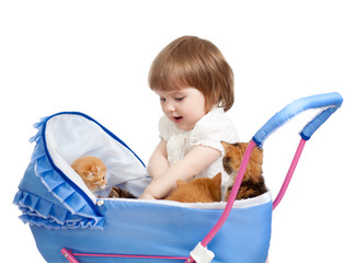 girl with baby carriage and kittens inside