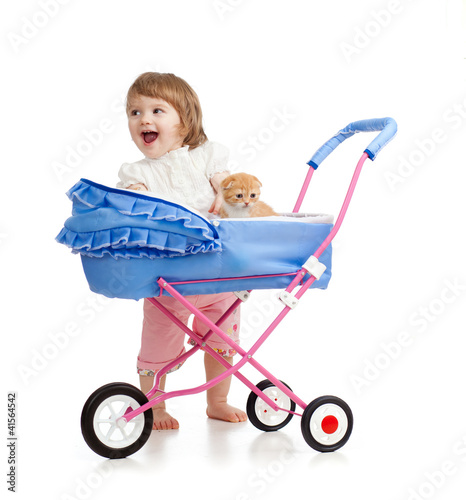 happy girl with baby carriage and kitten inside