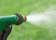Water spraying from garden hose