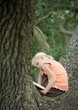 Girl in tree reading