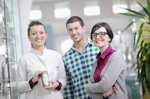 pharmacist suggesting medical drug in pharmacy drugstore