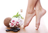 Fototapeta Beautiful legs and different spa items