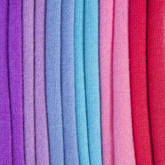 Pile of multicolored knitted clothes