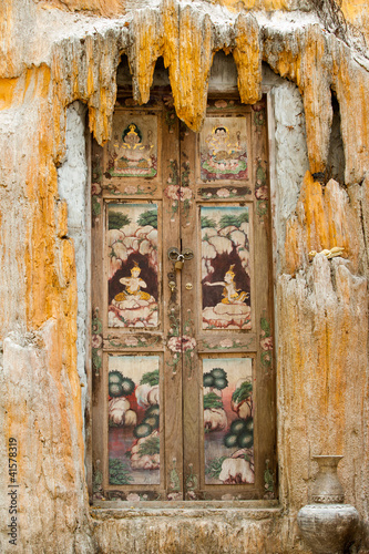 beautiful thai art painting on the old door of Thai temple
