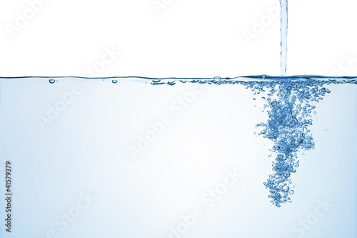 Flowing water with air bubbles. - 41579379