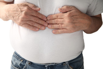 a man feels pressure in the center of his chest