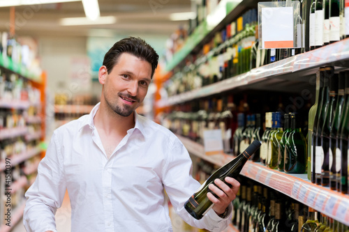 Young Man Shopping for Liquor