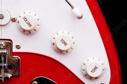 Vintage electric guitar volume and tune dials