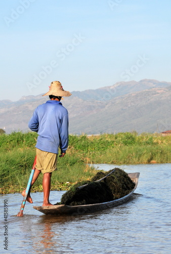 Inle Lake, Myanmar. Intha people leg-rowing style fishing