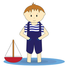 Little sailor - cute boy standing in the water