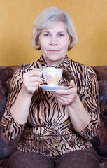 Adult woman resting with a cup of tea