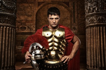 Roman soldier against antique building.