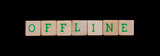 Green letters on old wooden blocks (offline)