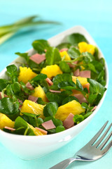 Fresh watercress, pineapple and ham salad in bowl