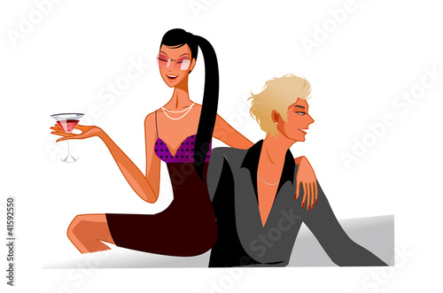 Couple sitting on sofa drinking red wine