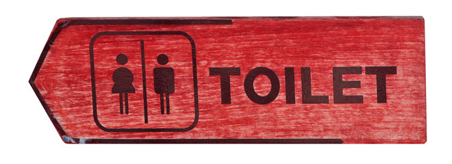 toilet plate sign on orange wall