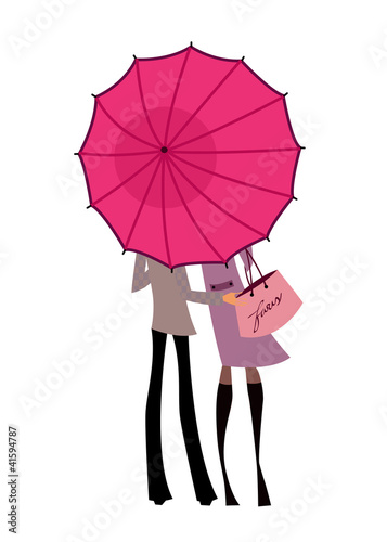 Couple standing under one umbrella