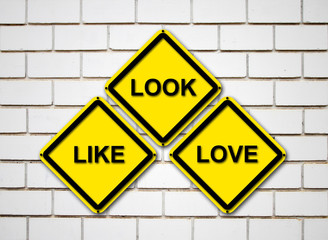 look, like, love sign on  brick wall background