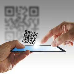 hand and tablet computer scan Qr code
