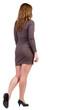 back view of going brunette girl in dress.