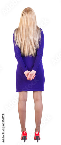 back view of standing beautiful blonde business woman.