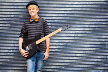 teen musician portrait with guitar outdoors