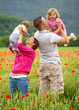 Family in poppy field