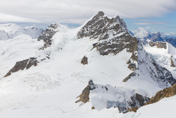 Mountain Jungfrau and mountain station Sphinx