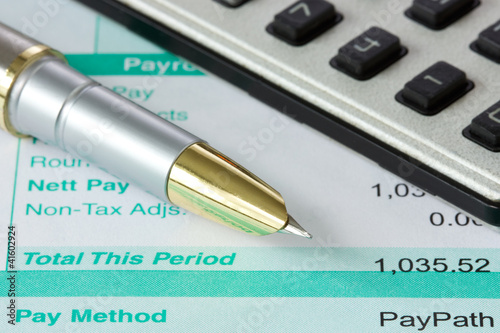 pen,calculator and payslip