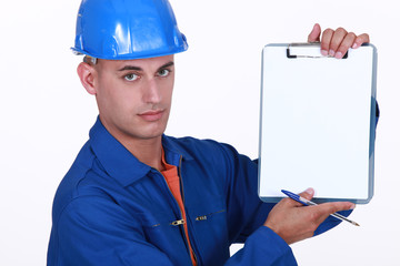 Tradesman holding up a blank clipboard