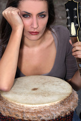 Woman with a bongo and guitar
