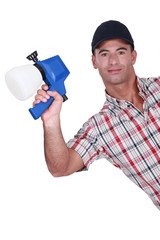 Man holding paint sprayer