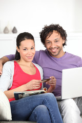 Couple makin purchase online