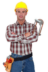 A plumber with his arms crossed.