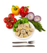Tasty pelmeni with tomato and salad
