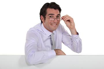A businessman making a weird face.