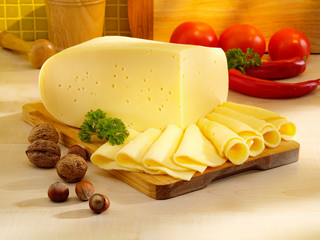 Ararangement with appetizing cheese on the kitchen table.