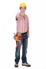 Worker with a safety hat raising his thumb