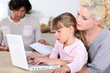Mother with girl and computer