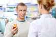 A young man at the pharmacy