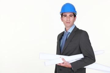 portrait of architect holding blueprints isolated on white