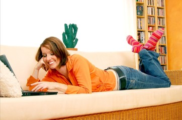 Young Woman with Laptop relaxing