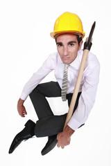 Businessman sat with axe